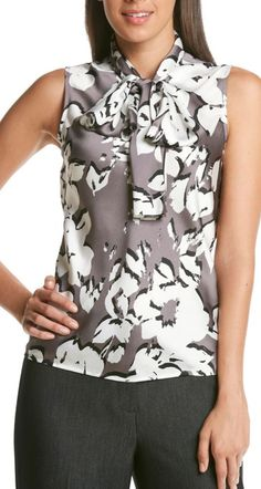 A floral sleeveless bow top from Nine West® that will look great by itself or with a blazer.