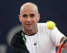 ANDRE AGASSI - Australian Open	(1995, 2000, 2001, 2003) - French Open (1999) - Wimbledon (1992) - US Open (1994, 1999)