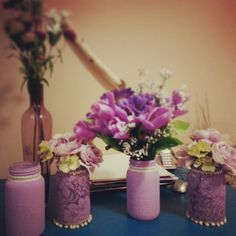 purple painted and lace wrapped mason jars for a bridal shower!