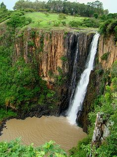 """Howick Falls is a waterfall in Howick, KwaZulu-Natal Province, South Africa. The waterfall is approximately 95 m in height feet) and lies on the Umgeni River. The Zulu people called the falls KwaNogqaza, which means """"Place of the Tall One"""". Great Places, Places To See, Beautiful Places, Local Legends, Namibia, Kwazulu Natal, Victoria Falls, Out Of Africa, Africa Travel"""