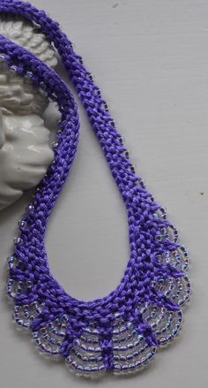 Knitting Pattern for Scallop Edge Beaded Necklace - The original pattern for the Scallop Edge Beaded Necklace featured in 101 Designer One-Skein Wonders. This version includes both the book version and a variation using finer yarns and smaller needles than the pattern in the book. Pictured project by tinpins