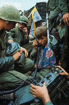 Feb 1968, Hue, South Vietnam --- A flowered arm sling is worn by a wounded U.S Marine in this makeshift communications center. --- Image by © Bettmann/CORBIS