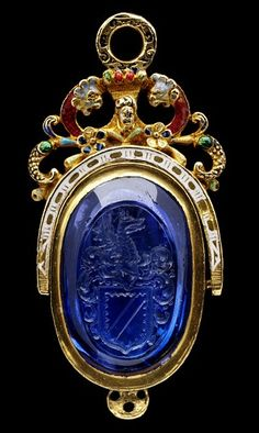 A Tudor seal and case. Sapphire seal engraved with the arms of Knyvett and mounted in enamelled gold, with a gold case, also enamelled. England, ca. 1580. #Tudor #seal