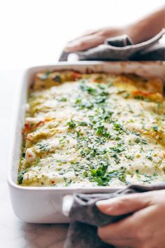 Enchiladas Verdes, with a simple homemade roasted tomatillo sauce that will make your tastebuds rock out. Plus chicken and cheese and tortillas, mushrooms if you're feeling wild. Super yum. | pinchofyum.com