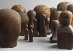 """A Rare Collection of Eighteen Milliner's Head Form Lasts (Sold) Solid Hand Carved Wood and Various Media  Largest 9"""" high, Smallest 4.5"""" high  France, c.1830 - c.1880"""
