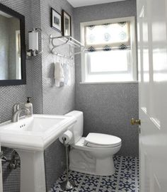 Tha classic Kohler pedestal sink; an efficient commode by Toto replaced the old water-wasting toilet. A