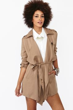 """Chic khaki trench featuring a double-breasted front and side pockets. Tie waist, button tab at shoulders. Fully lined. Looks perfect tossed over a rocker tee and skinnies! By Aryn K.    *Shell: 100% Tencel; Lining: 100% Polyester  *32.5"""" length"""