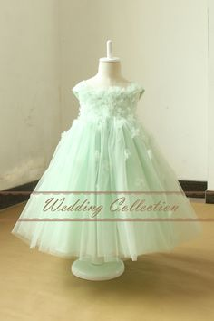 Mint Flower Girl Dress With Handmade Flowers and Pearls by Weddingcollection on Etsy https://www.etsy.com/listing/218156497/mint-flower-girl-dress-with-handmade