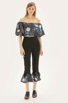 88b71476f15 Trousers with floral ruffle hem and floral embroidery. By prints by Mochi  for Topshop.