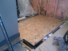 After the floor comes out, some of the glue and pressboard will remind attached to the joists.   In the middle is a section I removed with t...