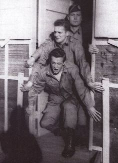 Malarkey, Skip, and Bill Dickerson pretending to jump out of a plane.  Camp Toccoa 1942