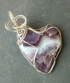 Check out this item in my Etsy shop https://www.etsy.com/listing/514228689/amethyst-heart-pendant-sterling-wire