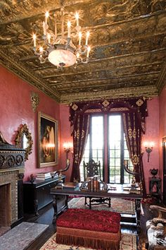 In the library, a mask of Bacchus, the Roman god of wine and revelry, looks down from a deep port-colored Venetian plaster wall. A nineteent...