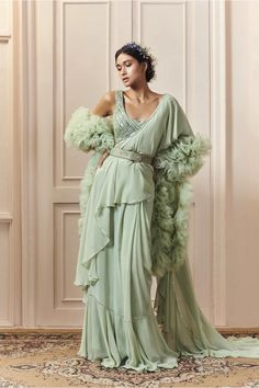 Sage green ruffle saree in georgette with a belt and matching top with silver salli (pipes) embroidery on net *Stole sold separately Indian Gowns Dresses, Indian Fashion Dresses, Dress Indian Style, Indian Designer Outfits, Designer Dresses, Indian Wedding Outfits, Indian Outfits, Wedding Lehenga Designs, Diwali Outfits