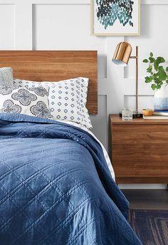 Detalhe azul na roupa de cama