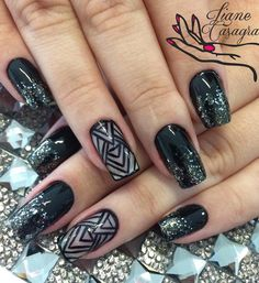 Tribal looking black nail art design. The black sequins tip is a good boost for fashion and can your clothes when you have neutral tones or maybe white.