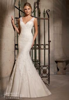 Mori Lee - Penrith. Chantilly lace decorated with venice lace appliques on net.