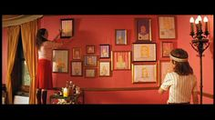 the pink wall with art - royal tenenbaums (luke wilson kid character - richie tenenbaum, the artist)