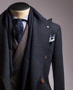 A subtle pin-dot tie really anchors down a look like this while matching with the lapel pins