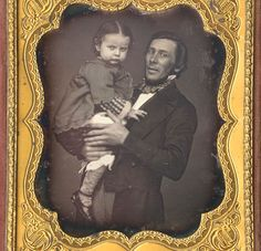 Sixth plate daguerreotype of standing man holding a little girl, by Lewis Babbitt, Worchester, Mass, c. 1855. Housed in full leather case.  The little girl doesn't seem thrilled with having her photo taken.  An opportunity to see her socks and shoes.