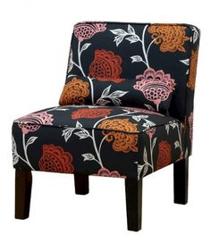 If your living room is surrounded in neutrals, this vintage-inspired chair will add an eye-catching detail. The dark background color makes it sophisticated enough for any style.