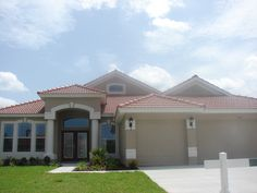 Harbour Isles.  This affordable luxury home has it all including a large bonus room, stunning tile roof, gourmet kitchen, double glass entry doors, tile floors everywhere but the bedrooms, bay windows, 3 car garage, luxury master bath, 10' flat ceiling and so much more.  Not to mention a beautiful oversized homesite which is 70' wide with a lake view.  Apollo Beach Florida 33672