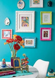 blue wall. colored frames