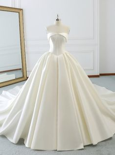 Strapless Wedding Dresses Ivory White Ball Gown Strapless Satin Wedding Dress With Long Train - Description Silhouette:ball gown Hemline:floor length Neckline:strapless Fabric:satin Shown Color:ivory Sleeve Style:sleeveless Back Style:lace up Wedding Dress Tea Length, Long Wedding Dresses, Perfect Wedding Dress, Boho Wedding Dress, Bridal Dresses, Wedding Gowns, Wedding Dress Long Train, Dresses Elegant, Pretty Dresses