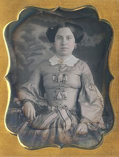 girl in very tight bodice (see a severe corset line)