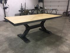 Reclaimed bowling alley table with our Worxx I-Beam base