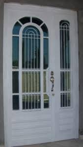 Resultado de imagen de puertas entrada principal con cristal y reja