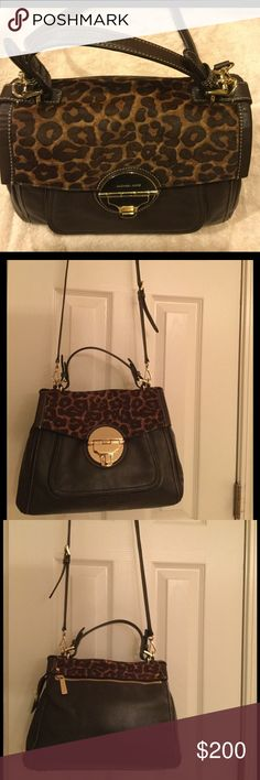 Michael Kors Chocolate Brown Hair Calf Purse EUC like new Michael Kors satchel/handbag features brown leather with a leopard hair calf print. Gold tone hardware, 4 interior slip pockets, outside front pocket, rear zippered pocket, interior zippered pocket, protective feet on the bottom, and MK logo fabric inside. Approximately 10.5 inches high and 13 inches long. Michael Kors Bags Satchels