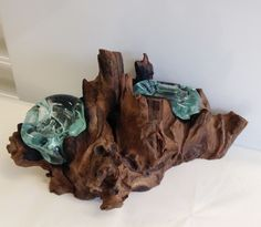 This, one of a kind, unique candle holder began with a piece of a wood root and then a skilled artisan, who have a love and an eye for the art of glass blowing, begins blowing the molten glass onto th
