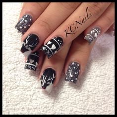 Winter sweater nails. White black silver charcoal grey. Heart and X sweater designs. And reindeer nail art. Hand painted  KCNails