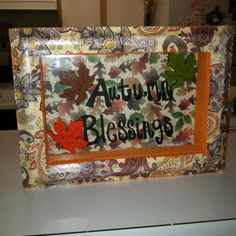 "I bought the shadow box, scrapbook paper and leaves from Hobby Lobby. I painted the frame orange and glued the scrapbook paper on the outside and inside. Then, glued the foam leaves and wrote ""Autumn Blessings."" Easy to do and inexpensive!"