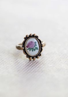 """Enchanted Rose Indie Ring 15.99 at shopruche.com. Perfected with vintage charm, this silver hued ring is adorned with a beautiful pink rose pendant., ,  Pendant is approximately 1"""" long x .75"""" wide."""