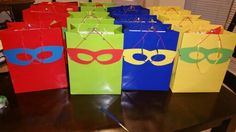 Superhero goodie bags with cut out masks