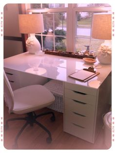 IKEA ALEX drawer units paired with an IKEA glass kitchen table top to create a desk.Beautiful desk for a home office