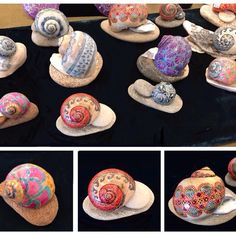 snail shells at gift shop each on its own rock and/or oyster shell pedestal - like they rolled out of the sea that way #hannahritter #hannahsellsshells #pysanky #pysanka #beeswax #batik #seashell #shellart  #seashellart #shellart #moonsnail
