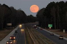 The full moon rises over Fayetteville, N.C. last December. This was the closest full mooon in 2008 and appeared larger and brighter than any full moon last year.    Johnny Horne/The Fayetteville Observer/AP