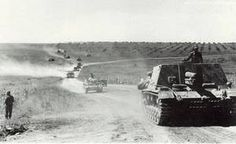 """""""A StuG 33 B is leading a column from Panzer-Regiment Panzer-Division on Eastern, Spring or Summer of"""