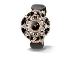 Bvlgari Diva Watch- Quartz movement, 39mm 18-ct pink gold case set with brilliant-cut diamonds, round-cut diamonds and onyx elements, black lacquered dial, satin strap, 18-ct pink gold buckle set with brilliant-cut diamonds.