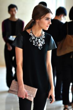 All black + statement necklace. Love this for holiday.