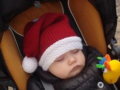 Santa's stocking cap for the baby with a funny knitted pom-pom in seed stitch. Such pom-pom looks really unusual and saves yarn.