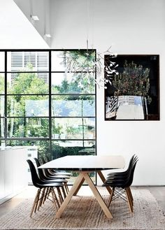 Pared back and minimal, we'd love a dining room like this! Get the look with a DSW Chair and Moooi Heracleum Suspension Light http://www.nest.co.uk/search/vitra-dsw-eames-plastic-side-chair http://www.nest.co.uk/search/moooi-heracleum-suspension-light Image via Designed for Life.