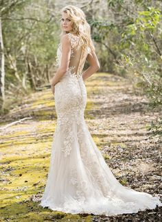 Allover embroidered floral appliques begin at the V-neckline and continue throughout the body of this fit and flare gown. The floral appliques also adorn the illusion back and finished hem lace. https://www.lillianwest.com/lillian_west/6472