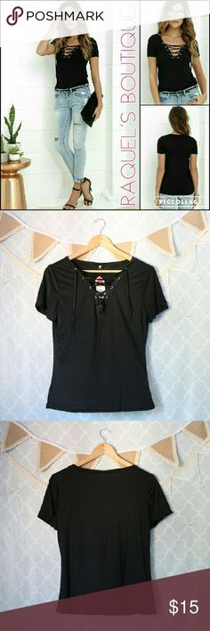 Black Lace Up T-shirt Details: Black lightweight short sleeve t-shirt with trendy adjustable lace-up front detail   Brand: Boutique Brand   Size: Small Measurements: Bust/30-32 inches? Length/23 inches  ? Size: Large Measurements: Bust/34-36 inches?? Length/24 inches   Size: X-Large Measurements: Bust/36-38 inches?? Length/24 inches   Condition: Still in original packaging Urban Outfitters Tops Tees - Short Sleeve