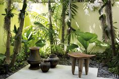 On the terrace, an Indonesian stool is grouped with Shona pots from Jalan Jalan Collection.