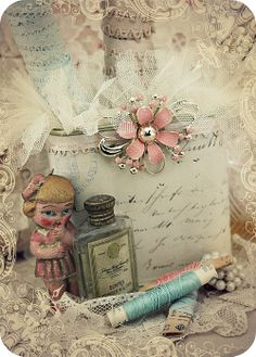 Beautiful altered box or tin, decopauged with wedding invitation and embellished with lace and vintage pin...a lovely idea for storing wedding memorabilia.