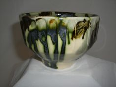 Earthenware tea bowl. Hand thrown, faceted   with oxide brush strokes.